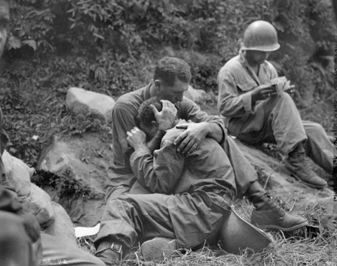 Soldiers crying friends holding each other in vietnam 1960s.