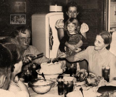 vintage family eating dinner together