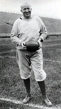 knute rockne standing on football field