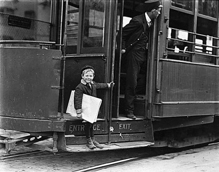 Vintage child standing on train stack for going to work.
