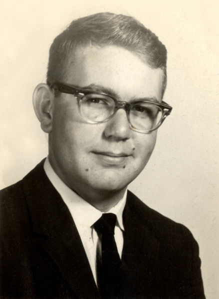 1950s man in horn rimmed glasses