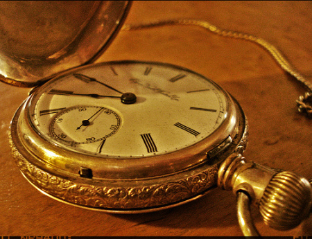 close up illustration of gold pocket watch