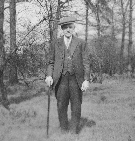 1920s man wearing morning coat in field vintage