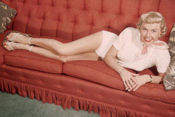 Doris Day actress singer laying on couch.