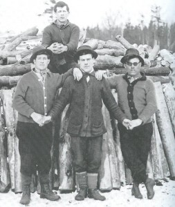 Vintage man holding hands of each others one sitting on tree logs.
