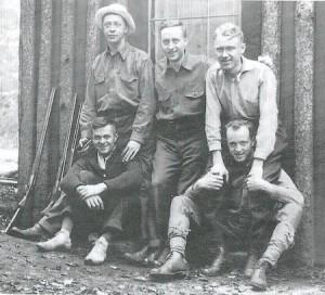 Vintage men with rifles.