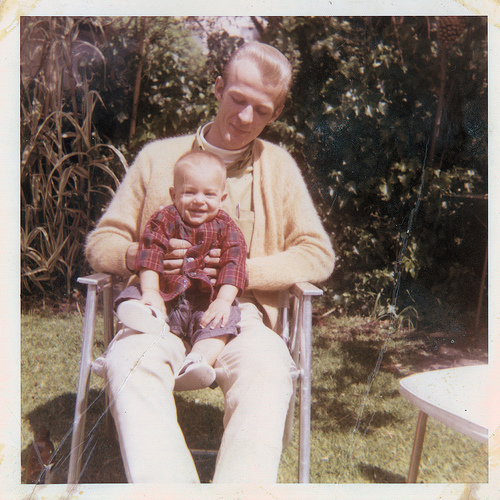 vintage father and infant son sitting 1950s 1960s