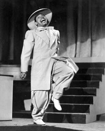 Cab Calloway performing on stage.
