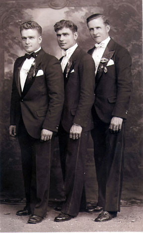 Vintage groomsmen standing for wedding portrait.