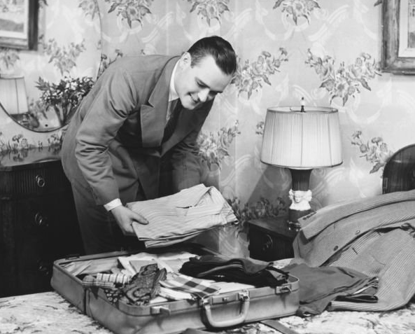 vintage businessman packing a suitcase 1950s