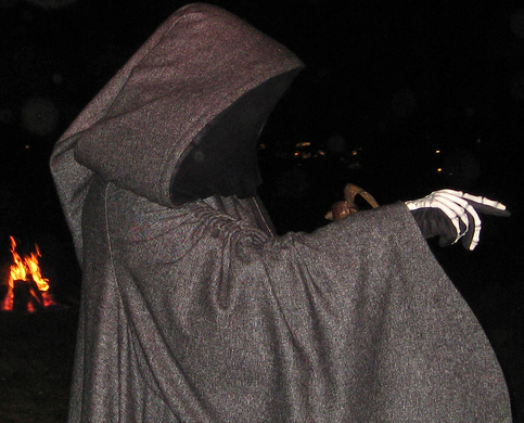halloween man dressed as grim reaper scare people