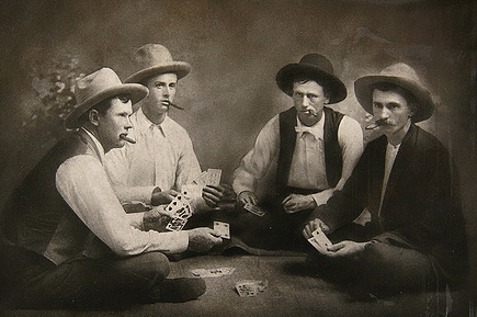 vintage men friends playing cards cigars late 1800s
