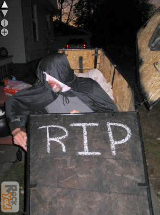 Halloween man coming out of coffin trick.
