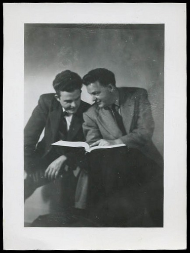 vintage friends men reading a book 1940s