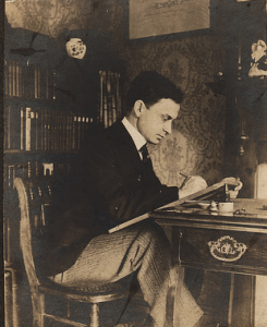 vintage man studying at desk late 1800s early 1900s