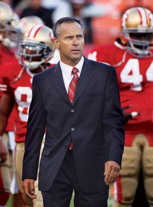 mike nolan 49ers head coach wearing suit sideline