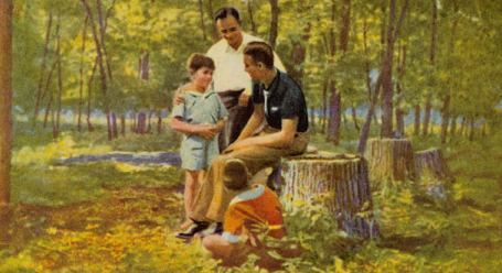 Father with sons in woods outdoors painting.