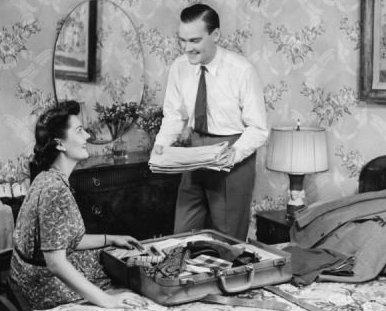 Vintage man packing suitcase with wife.