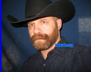 man with beard and cowboy hat grow facial hair