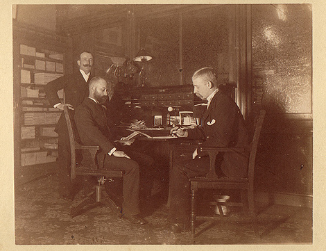 19th century office businessmen meeting