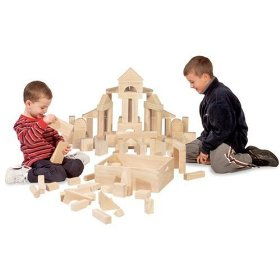Two kids making house with wooden blocks.
