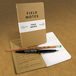 Field notes dairy and pens.