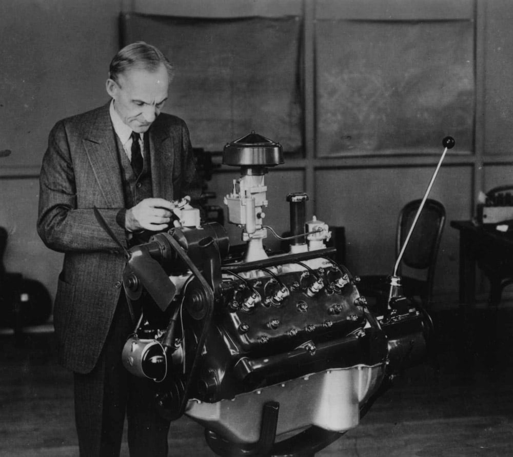 Vintage Henry Ford working with V8 Engine.