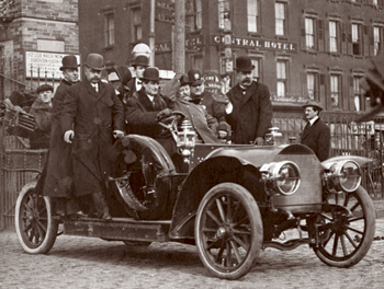 Vintage men sitting in old vehicle.