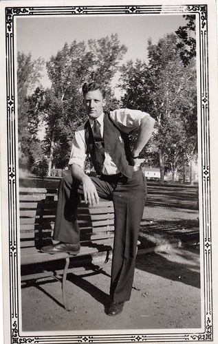 vintage man captain morgan pose on bench 1940s