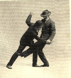 Vintage mnn sweeping kick aimed at the lower legs of an opponent.
