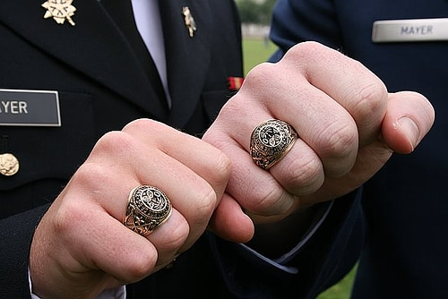 Cadets wearing gold ring in finger.