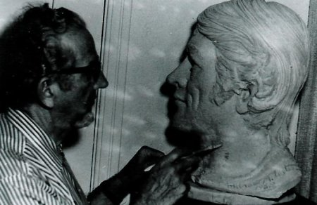 Vintage man sculpting the head.