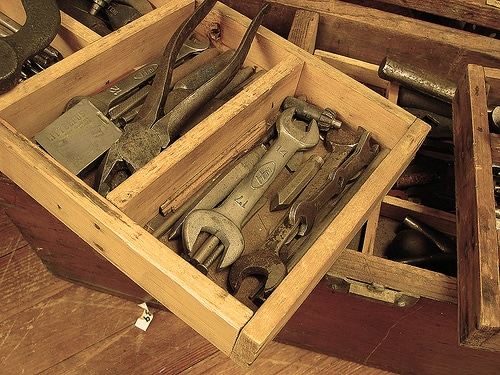 toolbox with vintage tool wrenches pliers