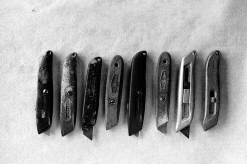 collection of utility knives razor blades