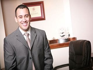 jeff rose financial planner pinstripe suit in office