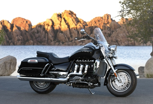 triumph rocket touring bike motorcycle next to lake