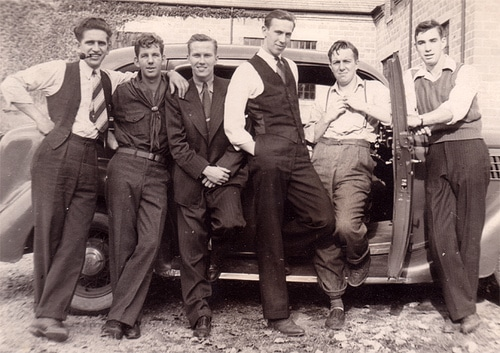 men friends together in front of car 1930s