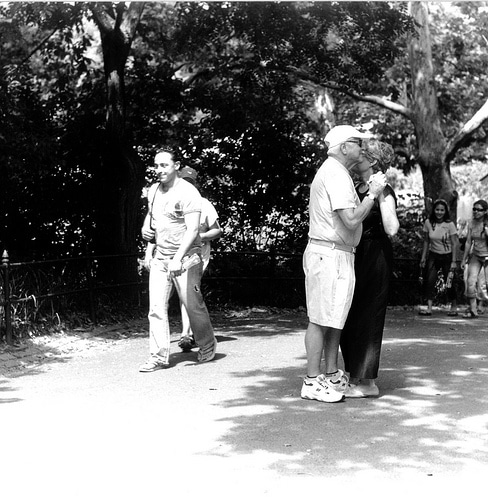 elderly couple dancing in public black white