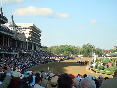 The crowd seeing the horse racing in derby.