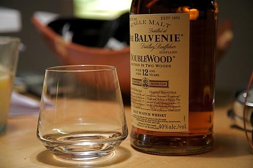 Balvenie scotch whisky with empty glass.