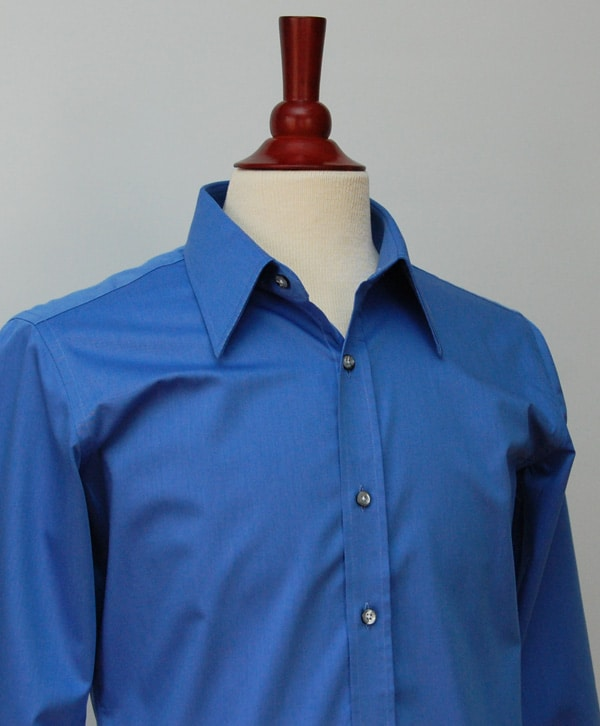 french blue shirt buttoned up on valet stand