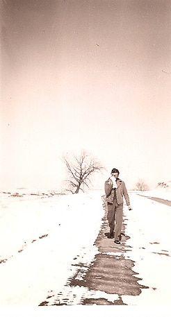 vintage sad lonely man walking snowy path