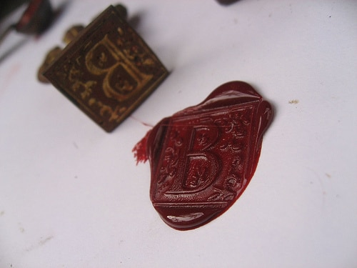 red letter wax seal and monogrammed stamp