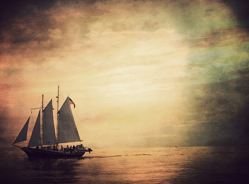 sailboat at sea dawn dusk vast coean