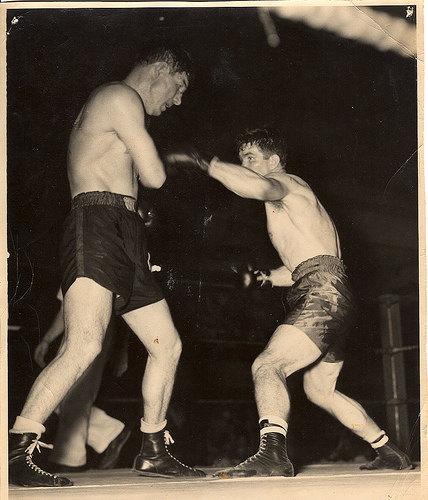 Vintage boxers fighting in the ring.