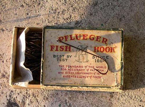 Pflueger Fish Hook an old box of fishing supplies.