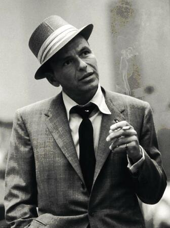 Vintage Frank Sinatra giving pose while smoking portrait.