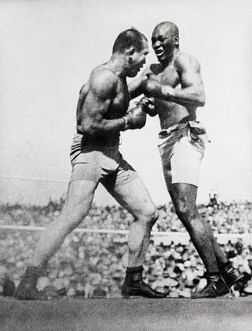Vintage Jack Johnson fighting with J Jeffries in boxing match.