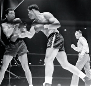 Vintage Joe Louis and Max Schmeling fighting in boxing match.