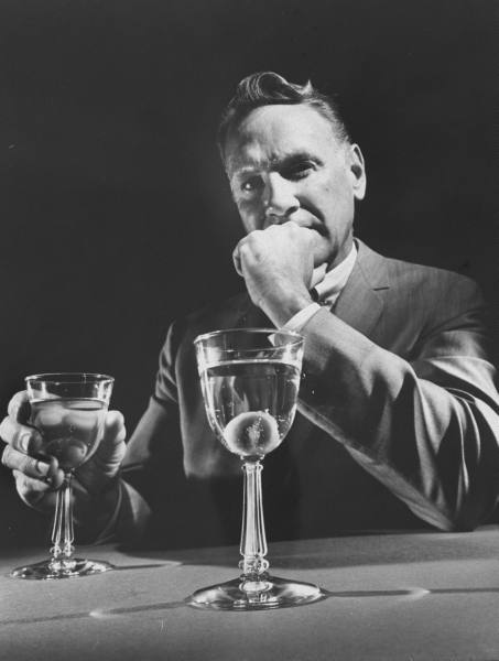 vintage man with martini cocktail at bar